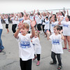 Salisbury: Kathy Manson, left, of Kathy's Tumbleweed School of Dance leads a group in a flash mob, though it was planned and not spontaneous as per usual, at Salisbury Beach on Wednesday night. The dance was to celebrate the demolition of the old Sidwalk Cafe and continuing improvements to the beach. Bryan Eaton/Staff Photo