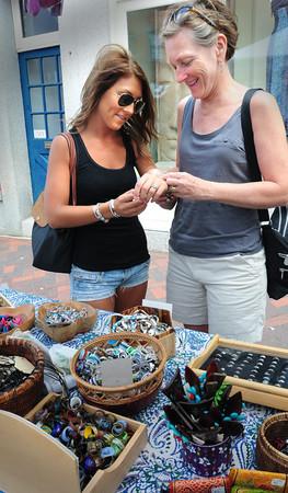 Newburyport: Laura Braun and her mother, Lynn Braun, of Newbury check out some bracelets at Ganesh Imports during Olde Fashion Sidewalk Sales. Bryan Eaton/Staff Photo