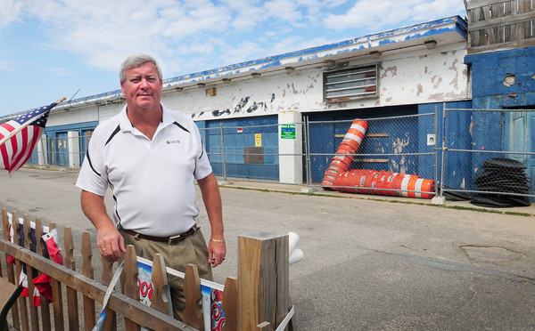 Salisbury: The Sidewalk Cafe at Salisbury Beach, which has been closed for a decade and is considered a big eyesore, back, is scheduled to come down next week. Kevin Buswell, who bought the Dolphin Bar and Grille across the way, partly because he knew the Sidewalk would be razed, is excited at the better view that will be afforded his customers. Bryan Eaton/Staff Photo