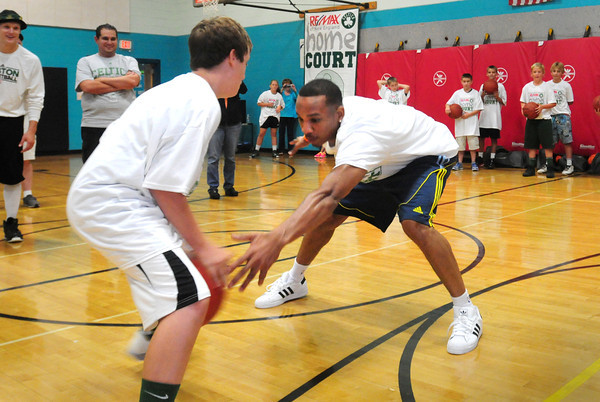 Merrimac: Celtics guard Avery Bradley knocks the basketball from Jake Webster, 13, as the Merrimac youngster and others took turns trying to get past the NBA player at a clinic at the Donaghue School in Merrimac. Bryan Eaton/Staff Photo
