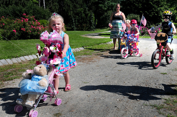 Newburyort: Lillian McCarthy, 2, of Amesbury plays the princess in the Bicycle and Carriage Parade at Kids Day in the Park. Bryan Eaton/Staff Photo