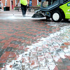 "Newburyport: Alan Frost of the Newburyport Department of Public Services sprays cleaner in Market Square before being scrubbed and vacuumed. Lack of rain has made areas there and on Inn Street gunky with spilled ice cream, etc. and ""snail trails"" caused when trash bags that can drip, are moved from cannisters to a dump truck. Bryan Eaton/Staff Photo"