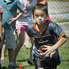 Salisbury: Lucas Bistany, 7, of Salisbury runs in a water balloon relay race Wednesday at the Boys and Girls Club. The activities got the kids' appetites worked up for the subsequent cookout which they have Wednesdays. Bryan Eaton/Staff Photo