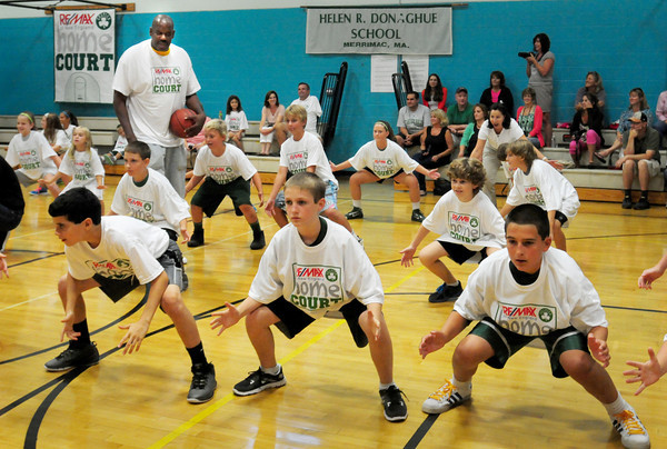 Merrimac: Former Boston Celtics player Cedric Maxwell instructs youngsters to get into a defensive position. Bryan Eaton/Staff Photo
