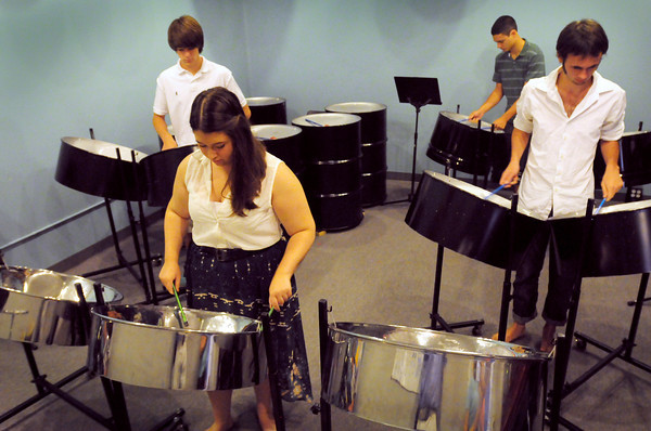 Newburyport: Steel drum band members at Zach Field Studio, clockwise from front, Lindsey Thurlow, Luca Provencal, Joe August and Eddie Gaudet. Bryan Eaton/Staff Photo