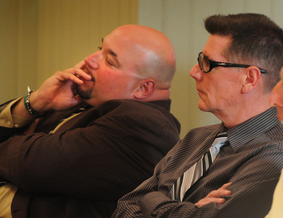 Salisbury: Salisbury liquor commission chair Gil Madeiros, and fellow member Chris Walsh, right, listen as commissioner Kelly Richenburg speaks to selectman in favor of keeping Madeiros on the board. Bryan Eaton/Staff Photo