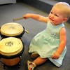 Newburyport: Marlie Field, 13 months, has drumming in her blood, banging on some congas in the Tannery Marketplace in Newburyport. Her dad, Zach Field, has his drum studio there and was with his steel drum students while she was banging away in the waiting room. Bryan Eaton/Staff Photo