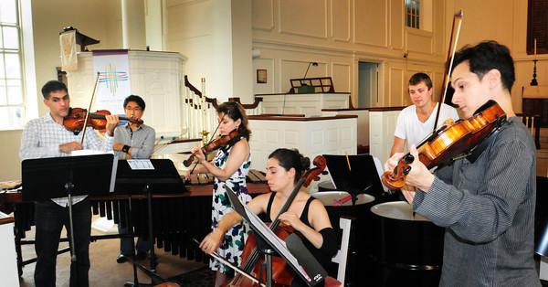 Newburyport: Performers with the Chamber Music Festival rehearse at St. Paul's Church in Newburyport. Bryan Eaton/Staff Photo