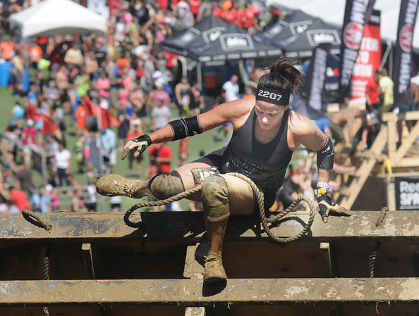 Amesbury:Mimi Depietro makes it over the climbing wall in the Spartan Race at Amesbury Sports Park Saturday. Jim Vaiknoras/staff photo