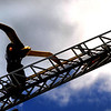 Seabrook: Seabrook firefighters Seth Coleman and Robert Mawson as he carries the seagull weathervane to the spire on Seabrook Town Hall Friday afternoon. The repaired weathervane was knocked off it's perch during a storm in February of 2010. Jim Vaiknoras/staff photo