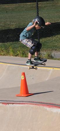 Newburyport: Finn Ingalls , 7, flies over a traffic cone at the Newburyport Skate Park Saturday afternoon. Jim Vaiknoras/staff photo
