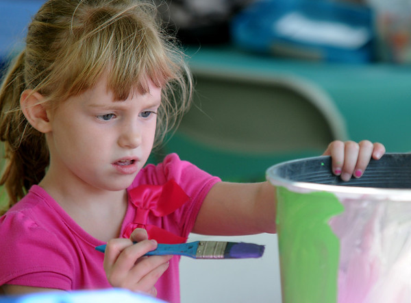 Seabrook: Julia Roy, 4, decorates a planter at Old Home Day at the Walton School in Seabrook Saturday. Jim Vaiknoras/staff photo