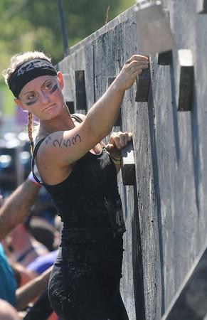 Amesbury: Megan Libby makes her way across the climbing wall at the Spartan Race at Amesbury Sports Park Saturday. Jim Vaiknoras/staff photo
