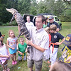 Newburyport: Corey Kummel of Curious Creatures shows off Big Al the alligator at Family Day at Maudslay Saturday. Jim Vaiknoras/staff photo