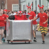 Newburyport: A lobster is all smiles as it sits in boiling water in the Bob Lobster entry in the Yankee Homecoming Lions Club Bed Race on Federal Street. Jim Vaiknoras/staff photo