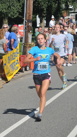 newburyport: High Street mile kids girls kids winner Madeline Quigley. Jim Vaiknoras/staff photo