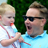 Newburyport: Parker Jackman , 2, enjoys a Rocket Pop with his dad Ken at the Yankee Homecoming Parade Sunday. Jim Vaiknoras/staff photo