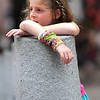 Newburyport: Ava Krajeski takes a rest as she leans on a concrete piller on Inn Street Sunday afternoon. She and her family wre visiting Newburyport for the day from Connecticut. Jim Vaiknoras/staff photo
