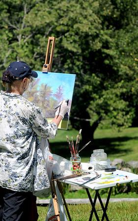 Newburyport: Candice Mitchell paints a scene at Maudslay State Park in Newburyport Sunday afternoon. Jim Vaiknoras/staff photo