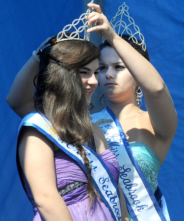 Seabrook: 2013 Miss Seabrook Shannon O'Hara gets some help with her tiara from 2012 Miss Seabook Kerri Sears at Old Home Day at the Walton School in Seabrook Saturday. Jim Vaiknoras/staff photo