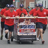 Newburyport: The Newburyport Fire Department runs to the finish line in the Yankee Homecoming Lions Club Bed Race on Federal Street. Jim Vaiknoras/staff photo