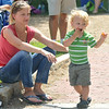 Newburyport: Mary Muckenhoupt Roy hold on to her son Miles as he dances and eats snacks at the Yankee Homecoming Parade Sunday.Jim Vaiknoras/staff photo