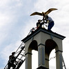 Seabrook: Steeplejack George Burgess gets some help from Seabrook firefighters Seth Coleman and Robert Mawson as he replaces the seagull weathervane to the spire on Seabrook Town Hall Friday afternoon. The repaired weathervane was knocked off it's perch during a storm in February of 2010. Jim Vaiknoras/staff photo