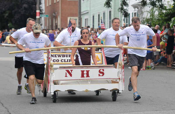 Newburyport: The Newburyport High School entry runs in the Yankee Homecoming Lions Club Bed Race on Federal Street Thursday night. Jim Vaiknoras/staff photo