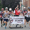 Newburyport: The Port City Pappy's lacrosse team races to the finish line in the Yankee Homecoming Lions Club Bed Race on Federal Street Thursday night. Jim Vaiknoras/staff photo