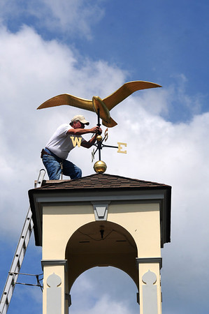 Seabrook: Steeplejack George Burgess replaces the seagull weathervane to the spire on Seabrook Town Hall Friday afternoon. The repaired weathervane was knocked off it's perch during a storm in February of 2010. Jim Vaiknoras/staff photo
