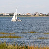 Newburyport: A sailboat glides along Joppa Flatts in Newburyport on a perfect summer day. jim Vaiknoras/staff photo