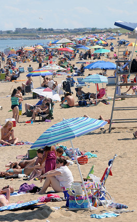 salisbury: Umbellas, swimmers and sun bathers crowd Salisbury Beach on a warm Monday afternoon. Jim Vaiknoras/staff photo