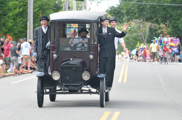 Newburyport: The boys from Paul Rogers Funeral Home make their way up High Street in an antique hearse at the Yankee Homecoming Parade Sunday.Jim Vaiknoras/staff photo