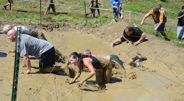 Amesbury:Runners crawl through the mud at the Spartan Race at Amesbury Sports Park Saturday. Jim Vaiknoras/staff photo