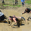 Amesbury:Runners crawl through the mud at the Spartan Race at Amesbury Sports Park Saturday. Jim Vaiknoras/staff photo