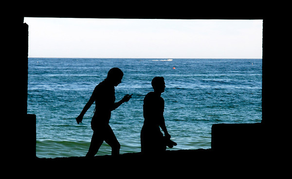 Salisbury: A couple walks in the shade under Seaglass on Salisbury Beach Saturday afternoon. Jim Vaiknoras/staff photo