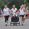 Newburyport: The Old South Women sprint to the finish at the Yankee Homecoming Lions Club Bed Race on Federal Street. Jim Vaiknoras/staff photo