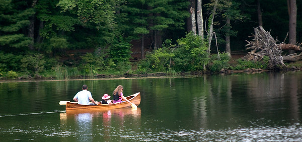 West Newbury: A trio paddle a canoe across Mill Pond in west Newbury late Sunday afternoon. Jim Vaiknoras/staff photo