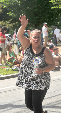 Newburyport: Chairman Tammy Jennings waves to the crowd as she marches in the Yankee Homecoming Parade Sunday.Jim Vaiknoras/staff photo