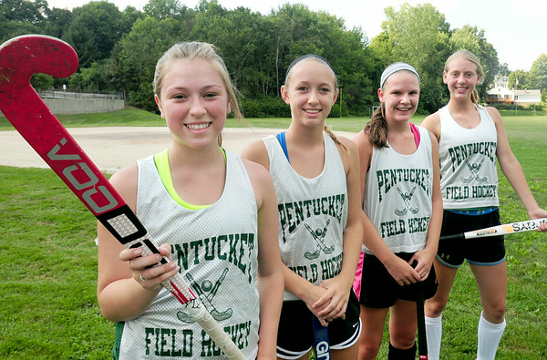 BRYAN EATON/ Staff Photo. Pentucket High field hockey captains, from left, Anna Gore, Becca Baier, Sam Fiore and Tyler Feeney.