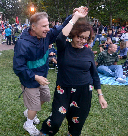 JIM VAIKNORAS/Staff photo Fredda Zuckerman of Cambridge and Larry Pearlman of Malden dance to the music of the Compaq Big Band in Market Landing Park in Newburyport Saturday night.