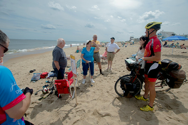 JIM VAIKNORAS/Staff photo Keith Harris and his wife Christina on Plum Island beach , Keith dipped his bike into the Atlantic Ocean on Plum Island after completing his 4,400 mile bike ride from Seattle to Newburyport. Harris's ride raised over $35000 for the Rotery Club.