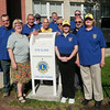 BRYAN EATON/ Staff Photo. Newburyport Lions Club members installed an eyeglass drop box in front of the Newburyport Public Library. They painted the mailbox which was donated by the Newburyport Post Office. Old glasses that are donated will be cleaned, scanned for optical prescription, repackaged and sent to people in need overseas.