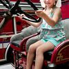 BRYAN EATON/ Staff Photo. Neves Marr, 4, of Seabrook sits atop an old Newburyport fire engine at Kids Day in the Park.