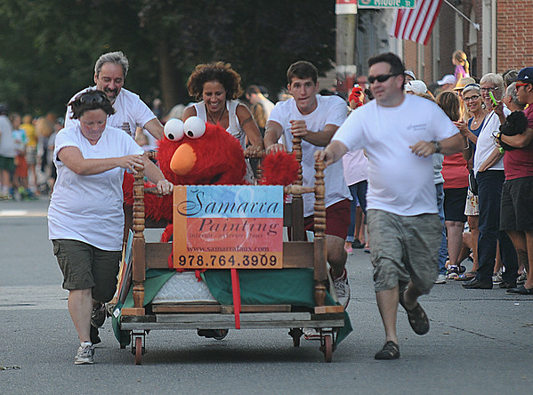 JIM VAIKNORAS/staff photo Samarra Painting got some help from Elmo at the Lions Club Bed Race on Federal Street in Newburyport.