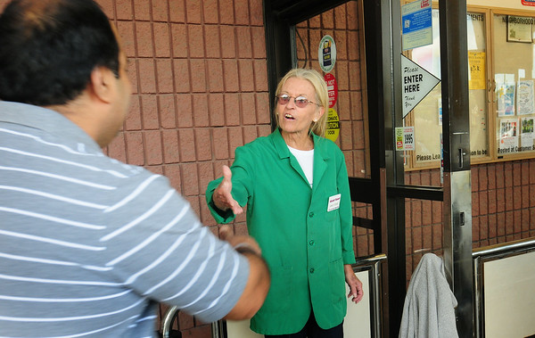 BRYAN EATON/ Staff Photo. Jane Gorrie greets and thanks returning customers to the Market Basket in Newburyport Thursday morning.