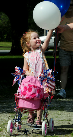 BRYAN EATON/ Staff Photo. Molly Heffernan, 3, of Action has a patriotic-themed carriage in the parade. Her mom, Amy, is originally from Newburyport.