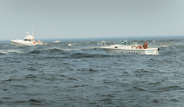 BRYAN EATON/ Staff Photo. Boaters fish in the mouth of the Merrimack River in a view from a US Coast Guard vessel.