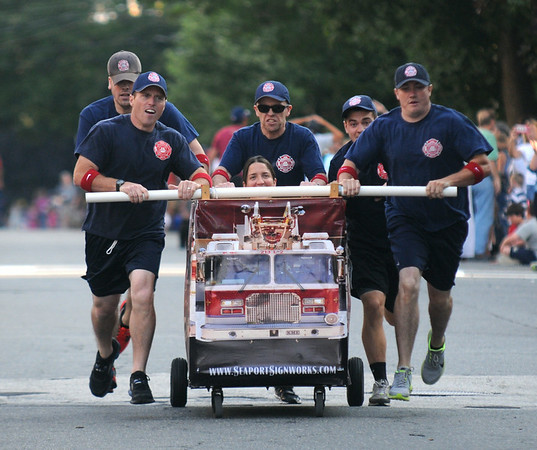 JIM VAIKNORAS/staff photo The Newburyport Fire Dept at the Lions Club Bed Race on Federal Street in Newburyport.