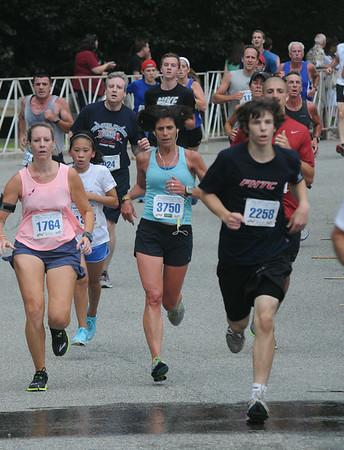 JIM VAIKNORAS/Staff photo Runners finish the Lions Club Yankee Homecoming 5k in Newburyport.